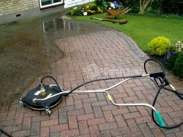 Block paving being cleaned with a rotary cleaner