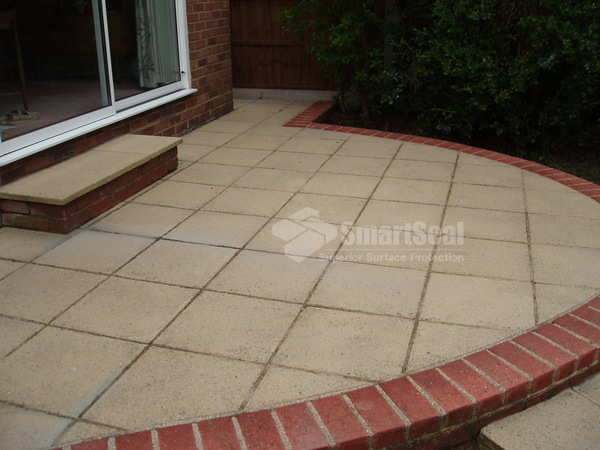 Patio subsequently pre-treated then pressure washed